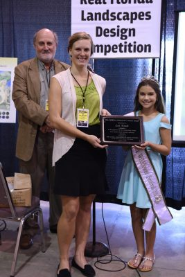 2016 Winner UF student Lea Kindt receives her plaque from little Miss Wildflower