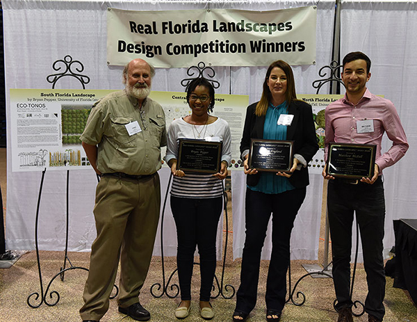 Craig Huegel with 2017 Real Florida Landscapes Design Competition award winners, from L-R: Ivy Henderson accepting on behalf of Bryan Pepper, Andrea England and Matthew McFall.