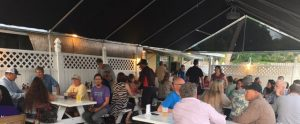 After move-in, exhibitors and volunteers gathered at Woody's River Roo on the Manatee River.