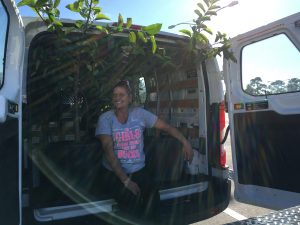 Angie Patchunka, Martin County Farms, rides along in the Uhaul to make sure our Pond Apples don't disappear.