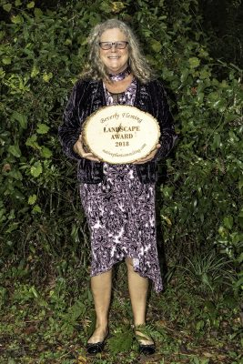 Jill Ziebell, Find Your Inner Dirt, with the Beverly Fleming Landscaping Award presented to St. Francis Inn, St. Augustine. Photo by Kay Wells.